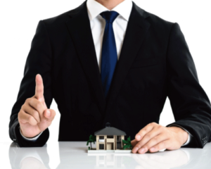 家の模型とスーツを着た男性がみぎの指を立てている